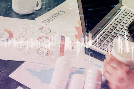 Double exposure of businessman with laptop and stock market forex chart. Reklamní fotografie - 135502632