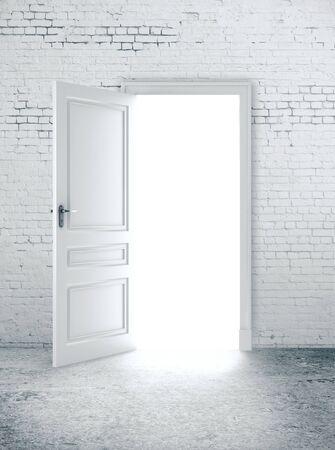 Open door in white brick wall. Way to success concept. 3D Rendering Stock Photo