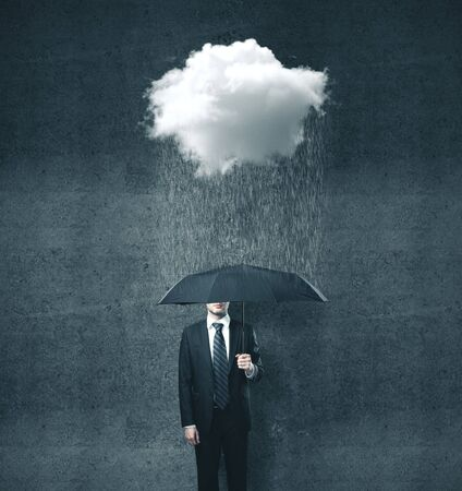 Businessman with umbrella and cloud with rain. Business and challenge concept.