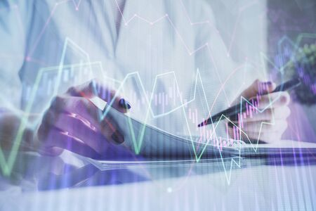 Financial chart drawn over hands taking notes background. Concept of research. Multi exposure Stok Fotoğraf