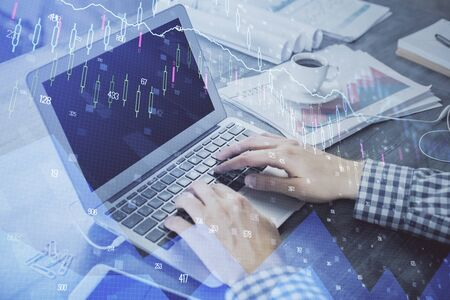 Double exposure of forex graph with man working on computer on background. Concept of market analysis. Stok Fotoğraf