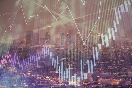 Financial graph on night city scape with tall buildings background double exposure. Analysis concept. 版權商用圖片