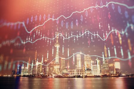 Financial graph on night city scape with tall buildings background multi exposure. Analysis concept. 版權商用圖片