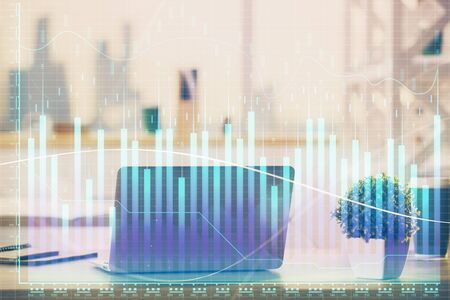 Stock market chart hologram drawn on personal computer background. Multi exposure. Concept of investment.