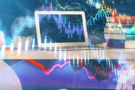 Financial chart drawing and table with computer on background. Multi exposure. Concept of international markets. 版權商用圖片