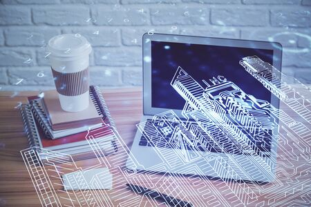Desktop computer background in office and big town buildings hologram drawing. Double exposure. Smart city concept. Stock Photo