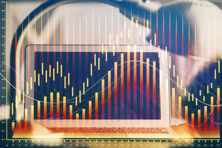 Financial graph colorful drawing and table with computer on background. Double exposure. Concept of international markets.
