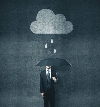 Businessman with umbrella and drawing cloud with rain. Business and challenge concept. Imagens