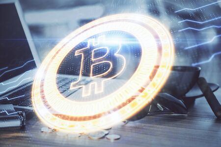 Double exposure of blockchain theme hologram and table with computer background. Concept of bitcoin crypto currency. Standard-Bild - 138457774