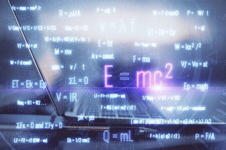 Desktop computer background and formula hologram writing. Double exposure. Education concept. Standard-Bild - 138461695