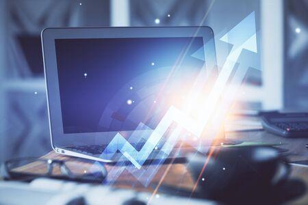 Computer on desktop with point up arrows hologram. Double exposure. Concept of success. Reklamní fotografie