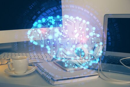 Double exposure of table with computer and brain hologram. Data innovation concept. Reklamní fotografie