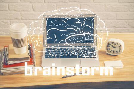 Desktop computer background in office and start up theme hologram drawing. Double exposure. Startup concept. Reklamní fotografie