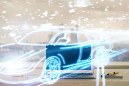 Desktop computer background in office with automobile hologram drawing. Multi exposure. Tech concept.