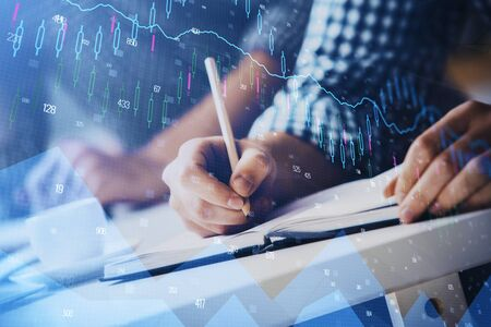 Multi exposure of two men planing investment with stock market forex chart background. Concept of research and trading. Reklamní fotografie
