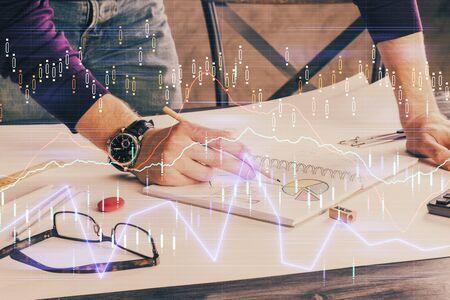 Financial trading chart doble exposure with man desktop background. Concept of success. Reklamní fotografie