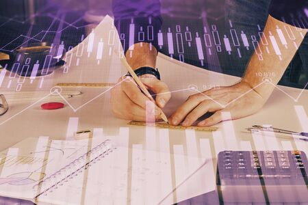 Double exposure of man writing on paper with forex graph. Concept of research and trading.
