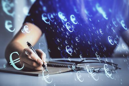 Multi exposure of womans hands making notes with forex graph hologram. Concept of technical analysis. Reklamní fotografie