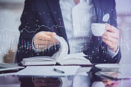 Double exposure of businessmans hands withcup of coffee with stock market graph background. Concept of research and trading. Reklamní fotografie