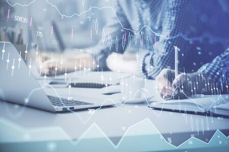 Multi exposure of forex chart with man working on computer on background. Concept of market analysis.