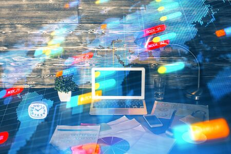 Double exposure of laptop computer and technology theme hologram. Concept of freelance work. Reklamní fotografie