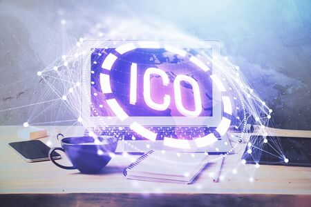 Double exposure of blockchain theme hologram and table with computer background. Concept of bitcoin crypto currency. Stockfoto