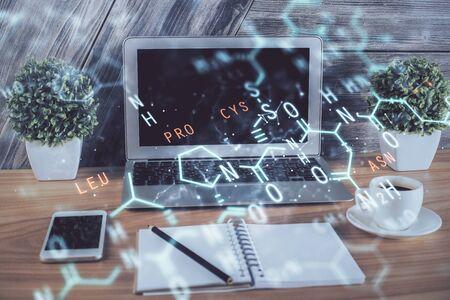 Desktop computer background and formula hologram writing. Double exposure. Education concept. Banco de Imagens