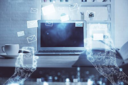 Desktop computer background in office and flying envelops hologram drawing. Multi exposure. Electronic mail concept.