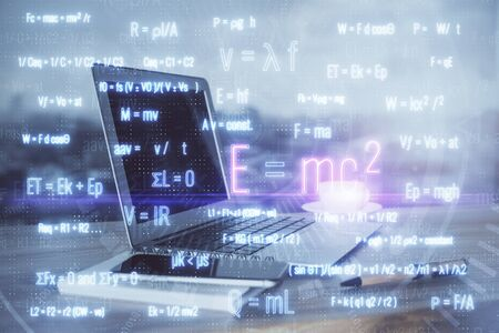Desktop computer background and formula hologram writing. Double exposure. Education concept. Foto de archivo