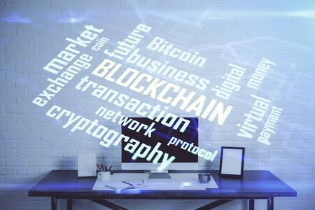 Double exposure of blockchain theme hologram and table with computer background. Concept of bitcoin crypto currency. Zdjęcie Seryjne