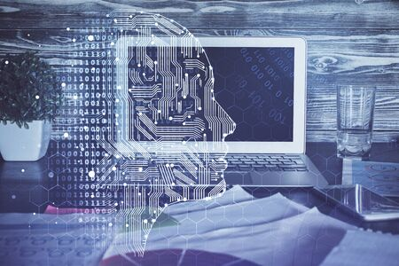 Double exposure of table with computer and brain hologram. Data innovation concept. Stock Photo