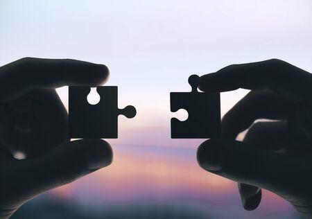 Hands putting puzzle pieces together. Close up. Business and challenge concept. Reklamní fotografie