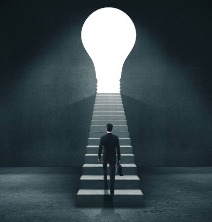 Businessman in concrete room walking to open door in form lightbulb. Motivation and startup concept.