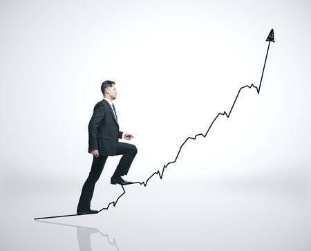 European businessman rises up a black business arrow. Business financial success concept