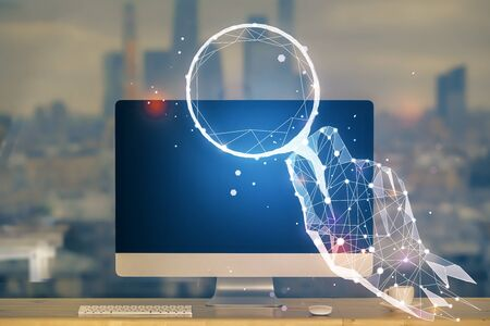 Desktop computer background in office and start up theme hologram drawing. Double exposure. Startup concept. 版權商用圖片