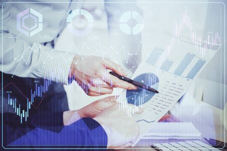 Financial trading graph double exposure with man desktop background. Concept of success.