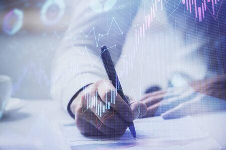 Financial trading graph multi exposure with man desktop background. Concept of success. 版權商用圖片