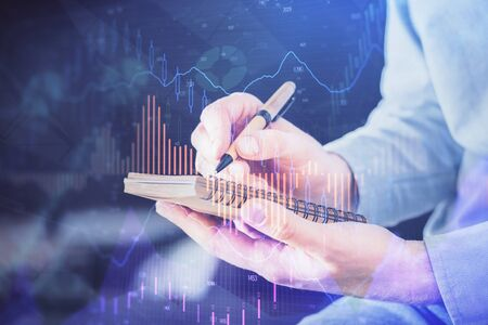 Double exposure hands with stock market chart. Concept of research and analysis.