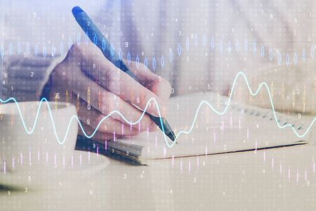 Forex chart displayed on womans hand taking notes background. Concept of research. Double exposure