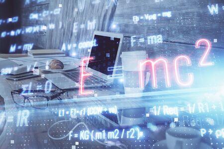 Desktop computer background and formula hologram writing. Double exposure. Education concept. Stock Photo