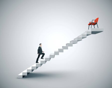 Businessman in suit climbing to chair on concrete ladder. Business and challenge concept.