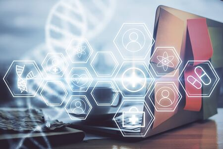 Desktop computer background and DNA drawing. Double exposure. Science concept. Stock Photo