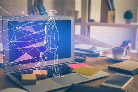 Desktop computer background in office and start up theme hologram drawing. Double exposure. Startup concept. Stock Photo