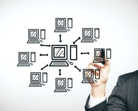 Businessman drawing cloud computing diagram. Cloud computing and business concept.