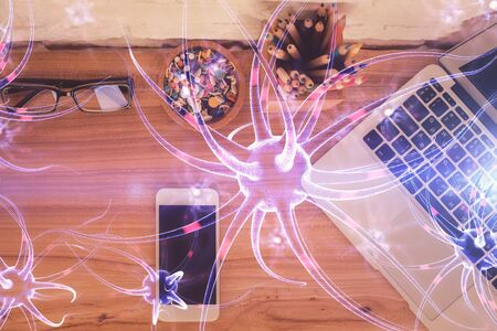Double exposure of neuron drawing over table with phone. Top view. Science education concept.