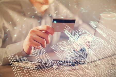 Double exposure of man hands holding a credit card and city drawing. modern town and E-commerce pay on-line concept. Archivio Fotografico
