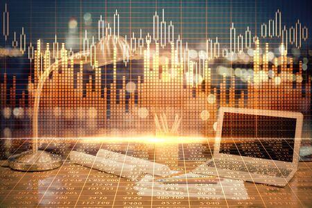 Double exposition du graphique et des informations financières et de l'espace de travail avec arrière-plan informatique. Concept de commerce international en ligne.