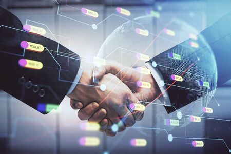 Double exposure of world map hologram and handshake of two men. International partnership concept.