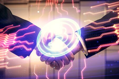 Double exposure of blockchain hologram and handshake of two men. Crypto business concept.