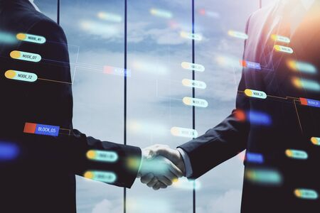 Double exposure of data theme hologram and handshake of two men. Partnership in IT industry concept.